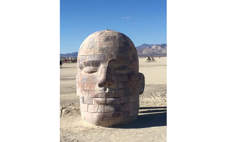 burning man sculpture of a head